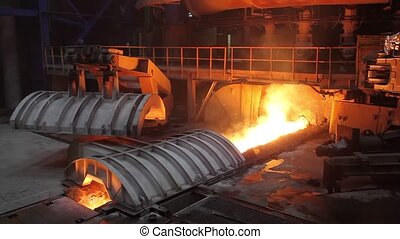 Blast furnace iron output ends, sparks fly, the damper is...