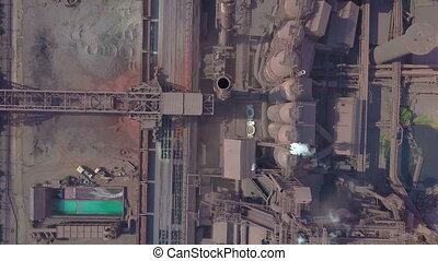 Blast furnace view from the air. Old factory. Aerial view over industrialized city with air atmosphere pollution from metallurgical plant.