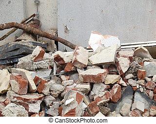 House debris following blast bombing and demolition