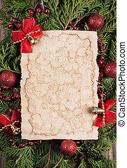 blatt papier, mit, weihnachtsdeko, auf, hölzern, hintergrund