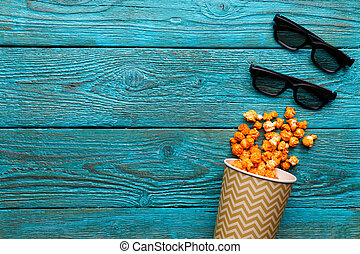 blaues, becher, oberseite, hintergrund., papier, popcorn, ansicht., gläser 3d