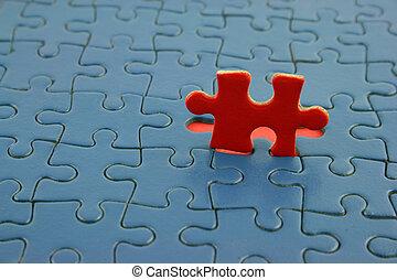 blaues, rotes , puzzlespielstück