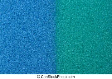 blaues, schaum, plastik, gummi, grüner hintergrund, stück