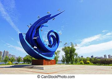 blauw vierkant, gebeeldhouwd kunstwerk