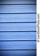 blauwe , geverfde muur, houten