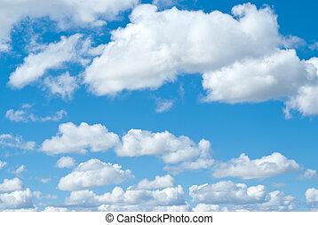 blauwe hemel, wite wolken