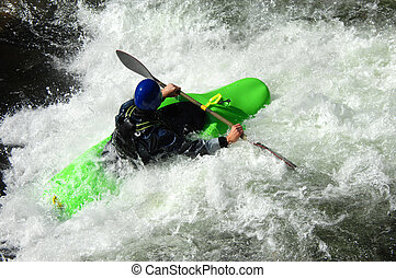 Blaze on brilliant green - Whitewater challenges kayaker on...