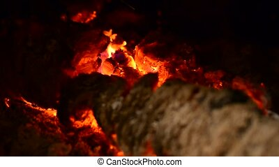 Blazing burning logs in the fireplace - View into a...