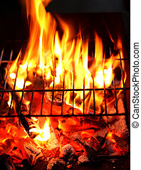 Blazing fire in Grilled. Close up. Whole background.