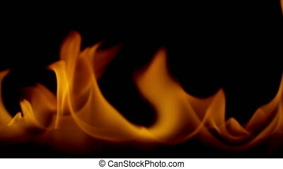 Blazing orange flames on black background 4k