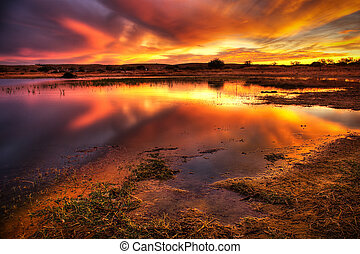 Blazing Sky - Landscape of a lake with an amazing cloudy red...