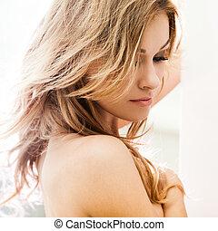 Beautiful brunette lady posing in bleached light