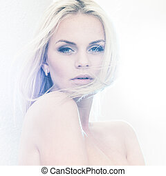 Bleached light - Portrait of a beautiful female model in...