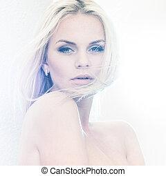 Bleached light - Portrait of a beautiful female model in...
