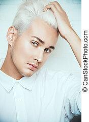 bleaching hair - Beautiful young man with sensual look...