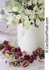 Bleeding-heart flower in vase with dry flower background