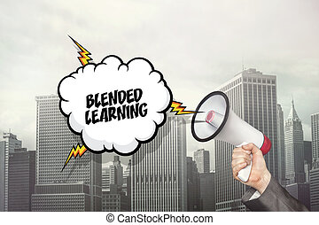 Blended learning text on speech bubble and businessman hand holding megaphone