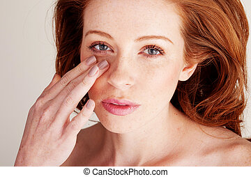 Blending Foundation With Fingertips - Attractive redhead...