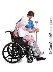 blessé, fauteuil roulant, infirmière, homme