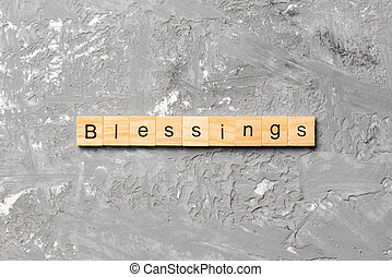 Blessings word written on wood block. Blessings text on cement table for your desing, Top view concept