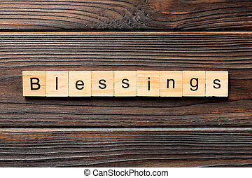 Blessings word written on wood block. Blessings text on wooden table for your desing, Top view concept
