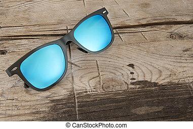 bleu, bois, lunettes soleil, fond