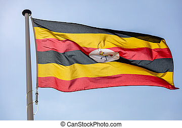 bleu, ciel clair, contre, drapeau ondulant, ouganda