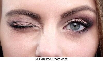 bleu, eyes., femme, closeup, winking.