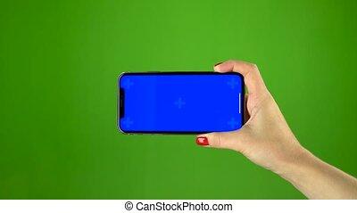 bleu, smartphone, écran, main, vert, tenue, sur