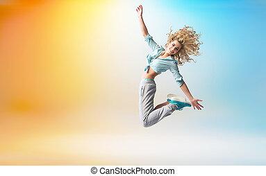 blij, schattige, blonde , atleet, springt