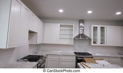 Blind cabinet island drawers and counter cabinets installed of white color