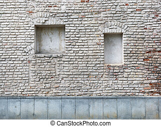 Blind curved basement windows in the old aged red bricks house