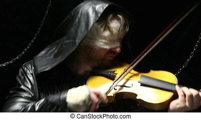 Blind fiddler playing on a broken fiddle, video on black...
