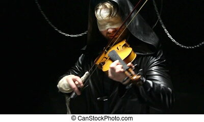 Blind fiddler playing on a fiddle, video on black background