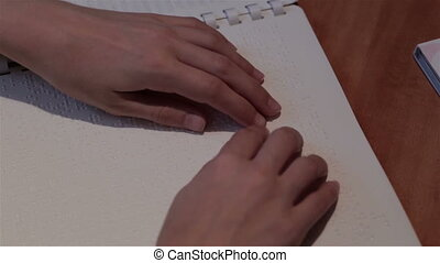 Blind hand with disability touch and read text braille system language