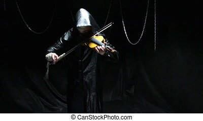 Blind musician playing on a fiddle