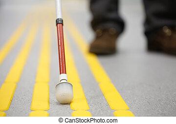 Blind pedestrian walking on tactile paving - Blind ...