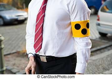 Close-up Of A Blind Person Wearing Yellow Armband