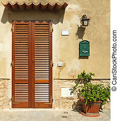 blinded door to the tuscan house, Italy