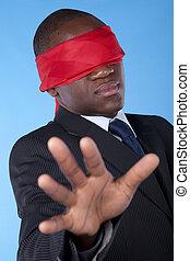 blindfold african businessman