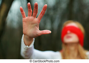 Blindfold - An image of woman with red blindfold