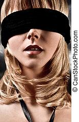 Closeup Of A Beautiful Blond Woman Blindfolded