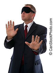 Businessman wearing a blindfold, Concepts: Confusion, Lost, Searching, Unsure plus many more.