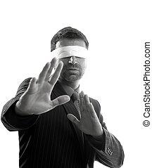 Blindfolded businessman over white background, defense...