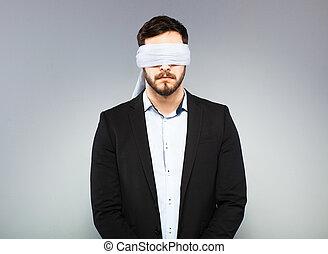Blindfolded elegant man - blindfolded office man in black...