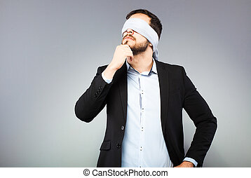 Blindfolded elegant man - blindfolded man looking up and...