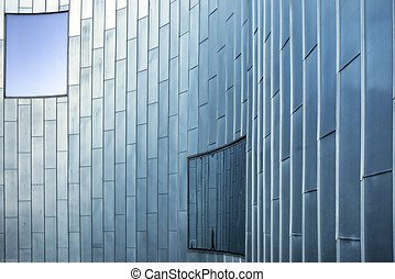 Blinds on windows of an office building. Modern business architecture with structural glazing and pattern of parallel lines.