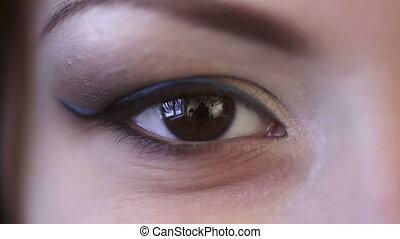Blink. - Eye of model, close-up.