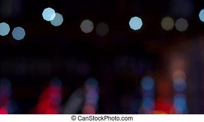 Blinking blurred lights in the dark in the hookah bar.