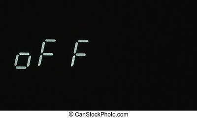 Blinking inscription OFF on the digital screen. Concept, digital symbol on screen